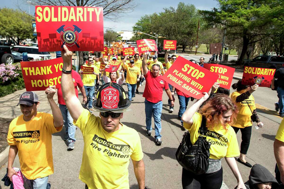 Houston firefighters a march on City Hall over a dispute related to Proposition B on Tuesday, March 19, 2019.