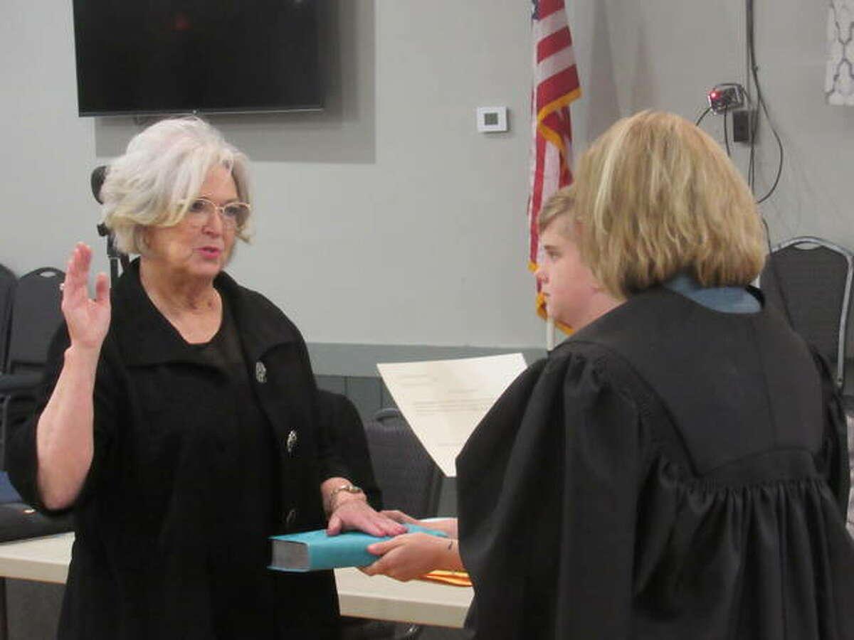 Sarah Woodman is sworn in Tuesday night as a village trustee in Godfrey.