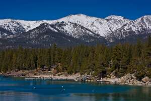 The beach and docks at Incline Village and nearby snow capped peaks.
