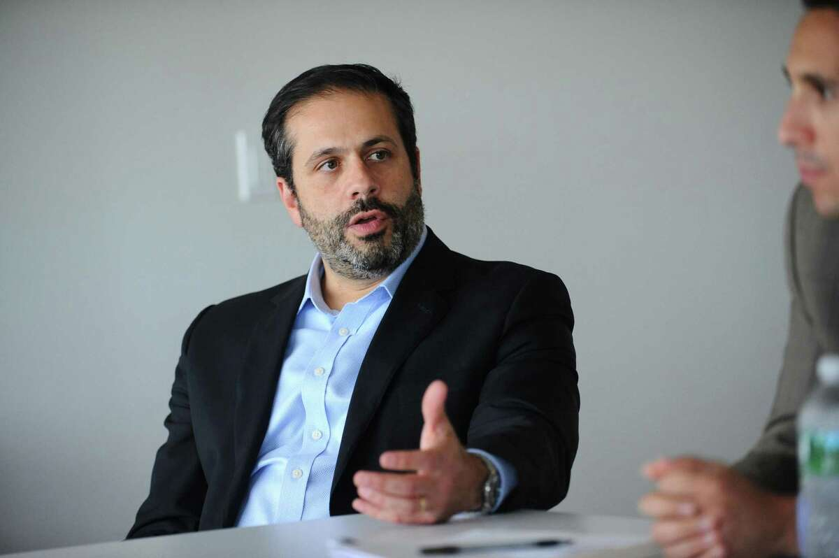 Dr. Joshua Bilenker, founder and then-CEO of Loxo Oncology, makes a point during an interview at the company's main offices on Tresser Boulevard in downtown Stamford, Conn., on July 18, 2017.