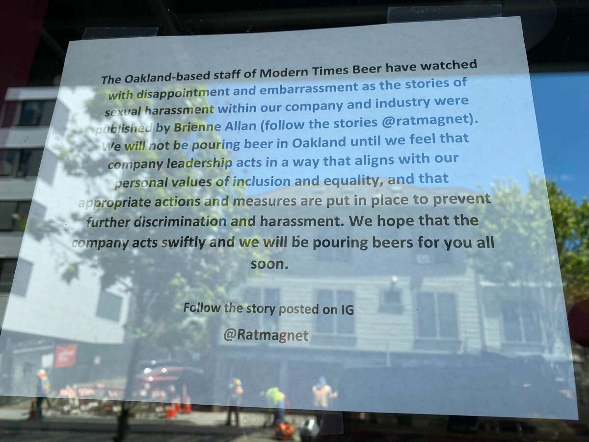 A statement from staff is posted in the window at the Oakland location of Modern Times on May 19, 2021.