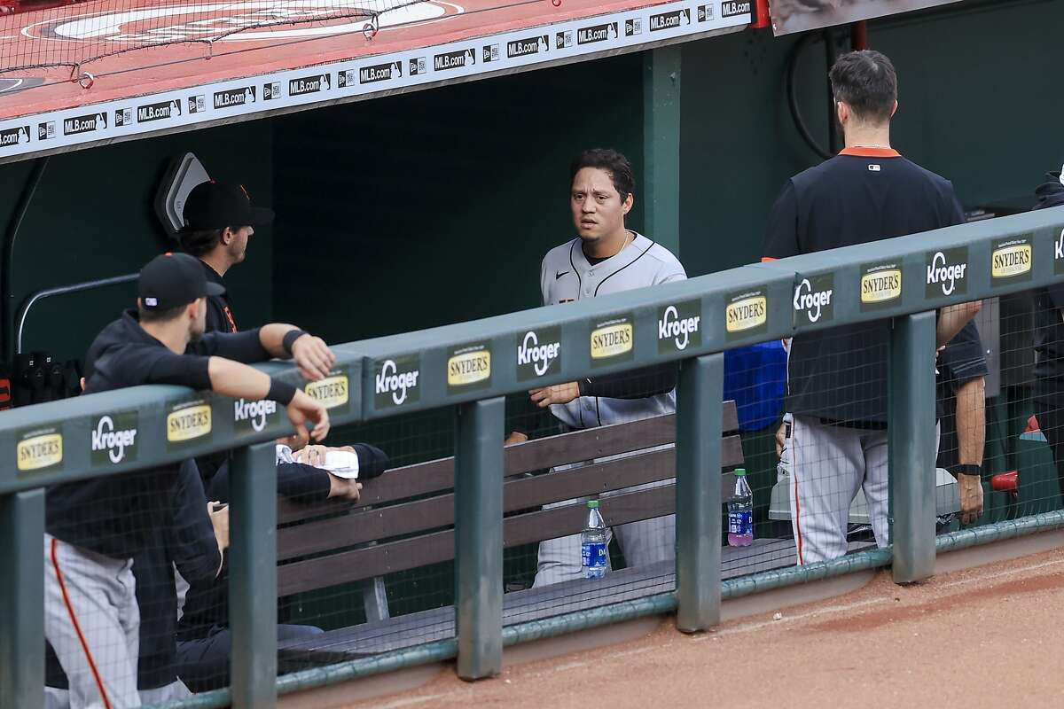 San Francisco Giants' Wilmer Flores walks through the dugout after exiting during a baseball game against the San Francisco Giants in Cincinnati, Tuesday, May 18, 2021. The Giants won 4-2. (AP Photo/Aaron Doster)