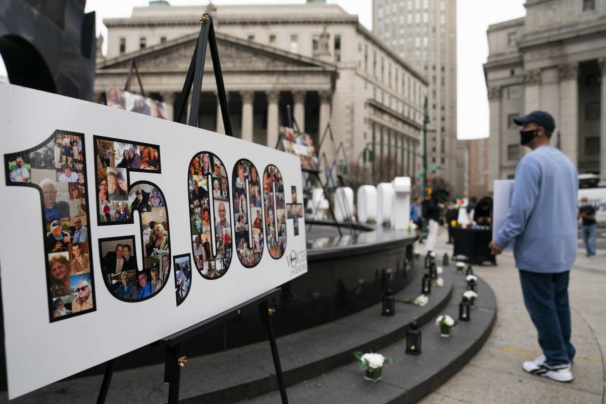 """Demonstrators gather beside a presentation depicting the number 15,000 to denote estimated nursing home deaths, before a rally decrying Gov. Andrew Cuomo's handling of the COVID-19 outbreak. Cuomo's office said it won't reveal what it told the U.S. Justice Department about COVID-19 outbreaks in nursing homes, partly because doing so would be an """"invasion of personal privacy.""""(AP Photo/John Minchillo, File)"""