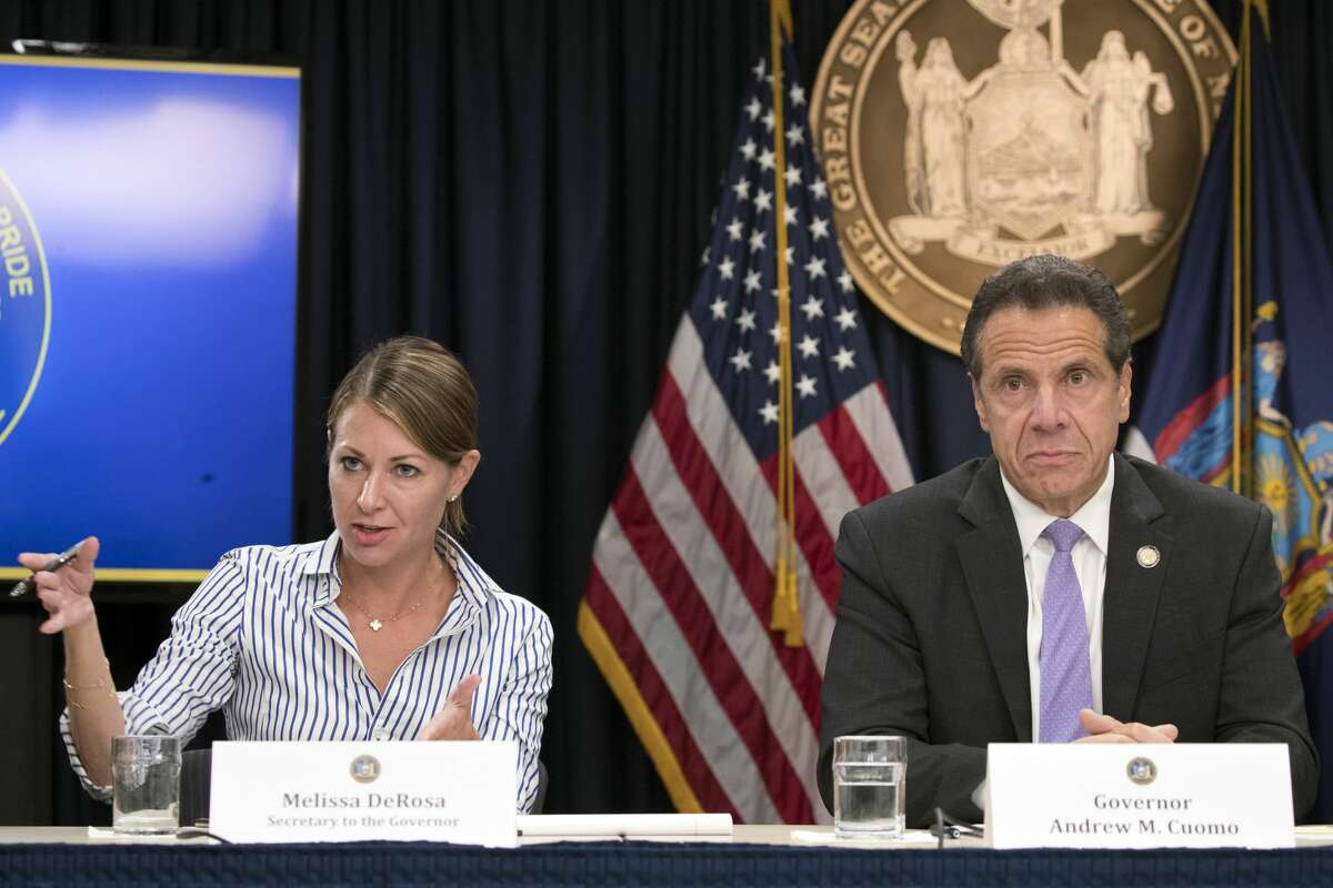 In this Sept. 14, 2018 file photo, Secretary to the Governor Melissa DeRosa, is joined by Gov. Andrew Cuomo as she speaks to reporters during a news conference, in New York. DeRosa was the person behind a series of controversial phone calls that some county executives felt mixed politics with the state's vaccine distribution efforts, according to a report released Tuesday. (AP Photo/Mary Altaffer, File)
