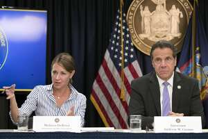 In this Sept. 14, 2018 file photo, Secretary to the Governor Melissa DeRosa, is joined by New York Gov. Andrew Cuomo as she speaks to reporters during a news conference, in New York. Top aides to Cuomo altered a state Health Department report to obscure the true number of people killed by COVID-19 in the state's nursing homes, The Wall Street Journal and The New York Times reported late Thursday, March 4, 2021. The aides, including DeRosa, pushed state health officials to edit the July report so only residents who died inside long-term care facilities, and not those who became ill there and later died at a hospital, were counted, the newspapers reported.(AP Photo/Mary Altaffer, File)
