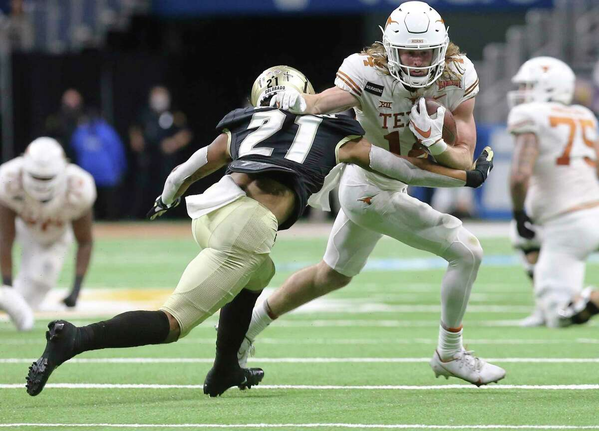 Texas' Brenden Schooler (14) runs after a catch against Colorado's Alec Pell (21) during the 2020 Valero Alamo Bowl at the Alamodome on Tuesday, Dec. 29, 2020.
