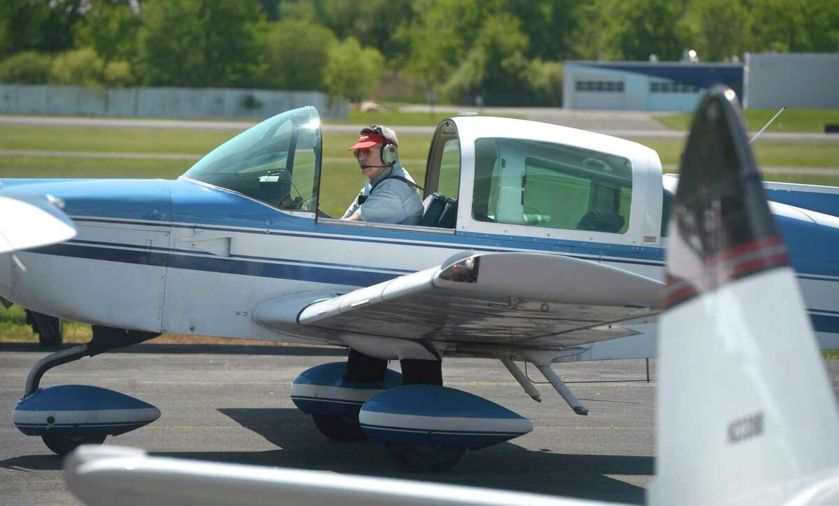 Pilot Keith Myles, from Massachusetts, arrives at Danbury Airport for a get together of UFOs, a group of pilots, all over 80 years old, called United Flying Octogenarians. They fly into Danbury Airport every year to meet and have lunch. Wednesday, May 19, 2021, in Danbury, Conn.
