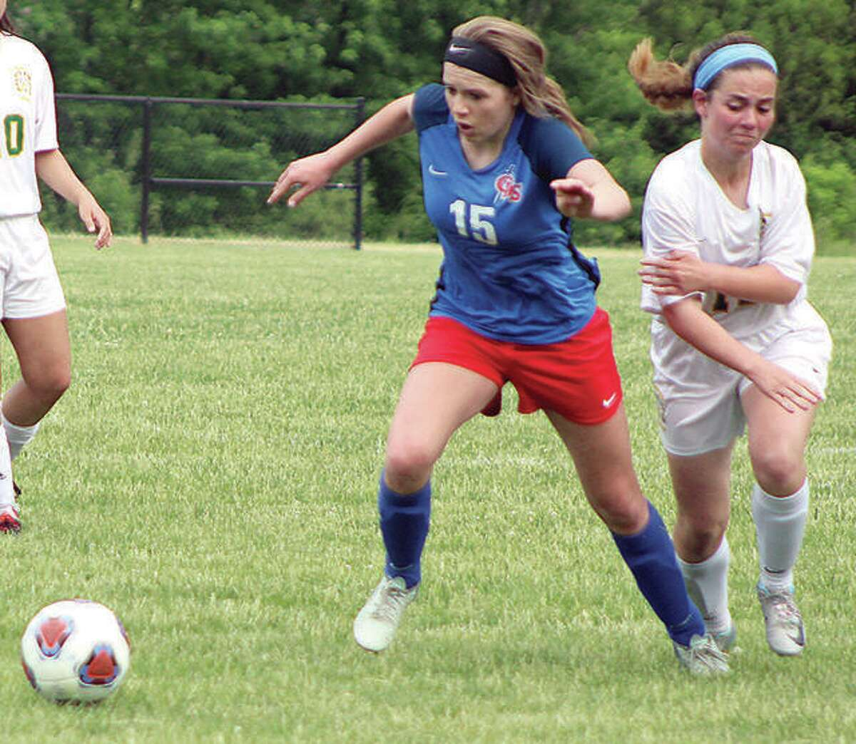 Gracie Reels (15) of Carlinville outraces a St. Thomas More player during the 2018 Class A Sectional final in Decatur. Reels, a three-sport standout at Carlinville, saw her senior season end prematurely when she tore an ACL early in the spring soccer season.