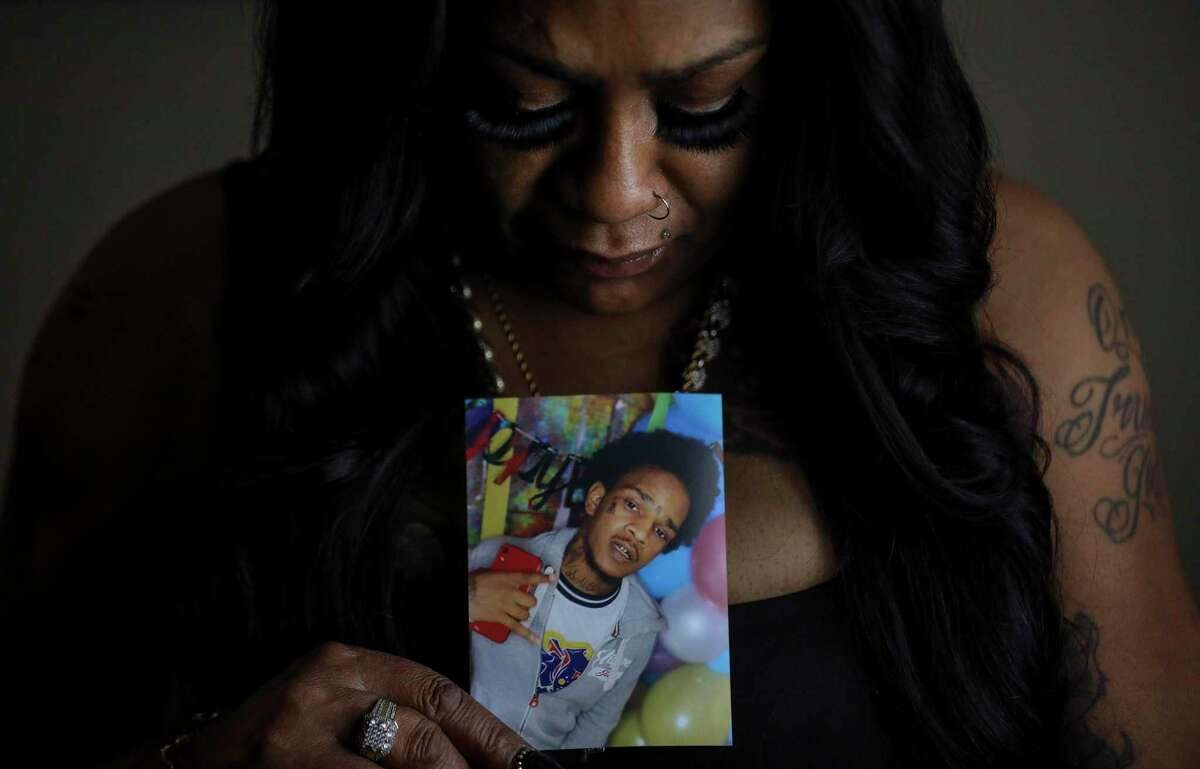 Larhonda Biggles with a photo of her late son, Jaquaree Simmons, on Wednesday, May 12, 2021, at her apartment in Houston.
