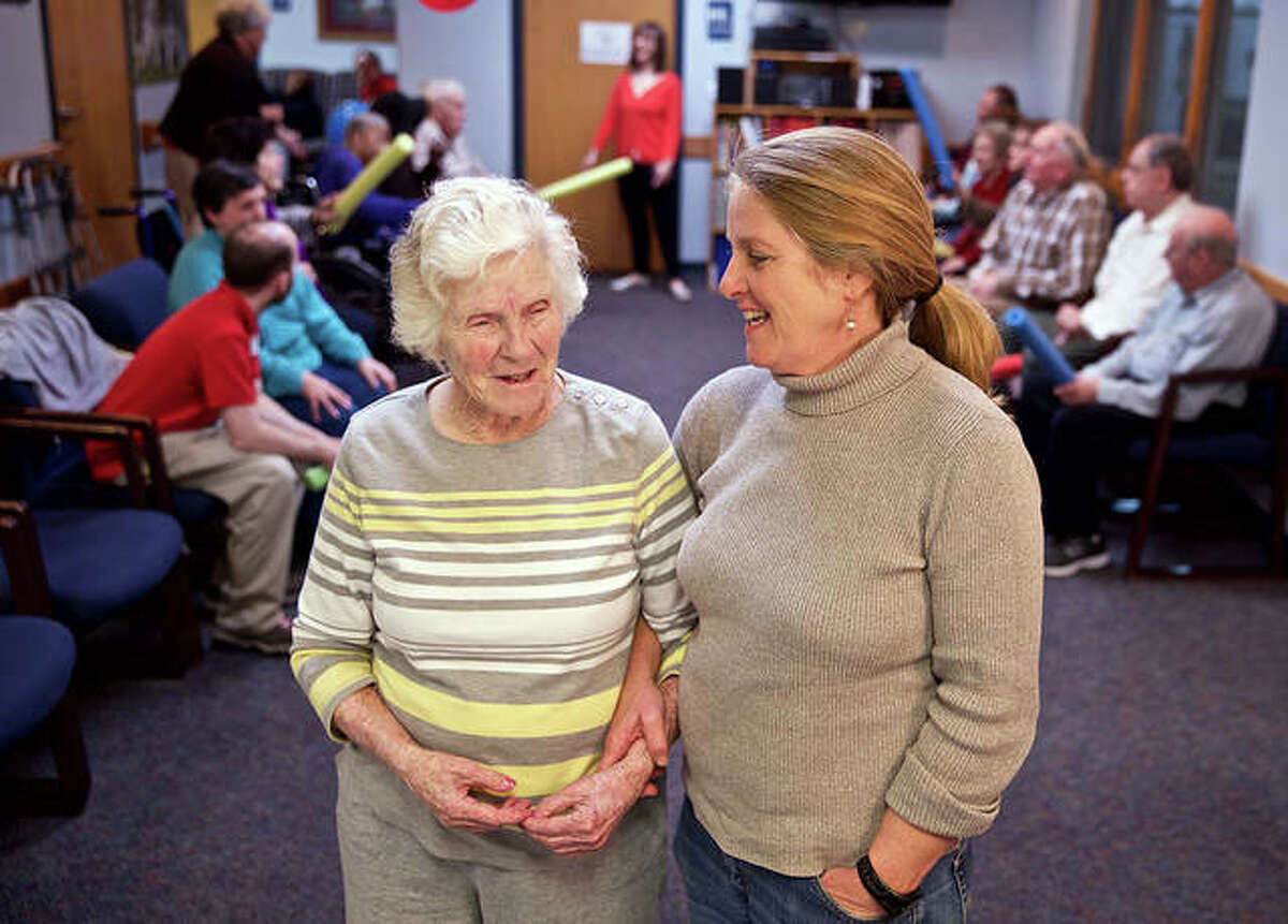 Pat Ciszczon is now 100 years old and attending the adult day program every day again at St. John's Community Care while her daughter Lisa Brennan, right, works. The photo is pre-pandemic before masks or social distancing.