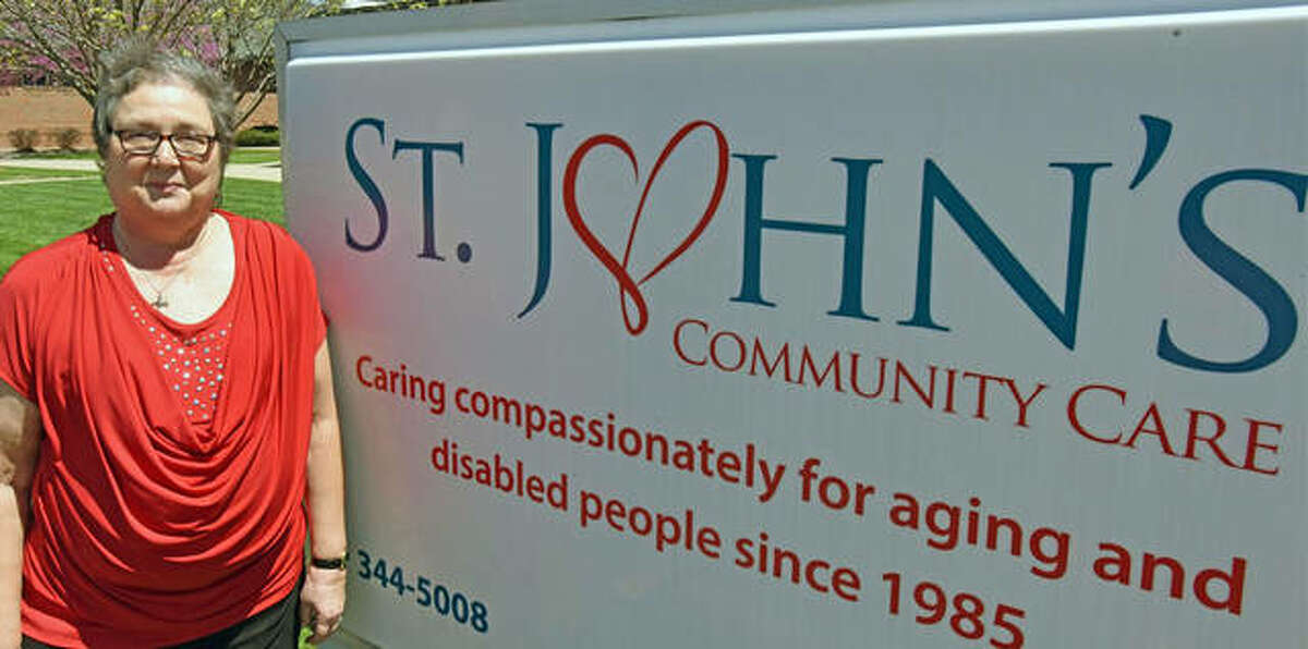 Nancy Berry, executive director of St. John's Community Care, stands in front of the Collinsville location at 222 Goethe Ave.