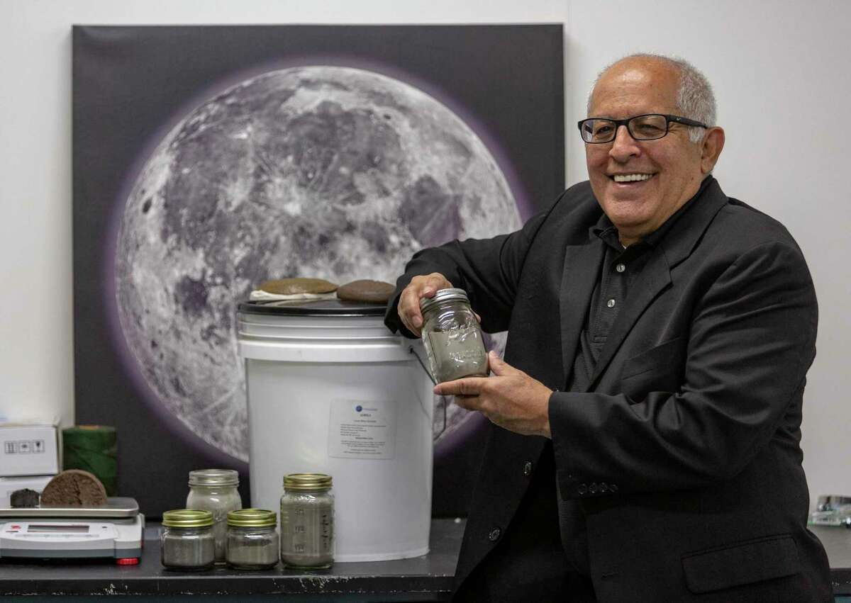 Exploration Architecture Corp. founder and CEO Sam Ximenes is seen May 19 in his Port San Antonio lab with some of the basalt powder with which his company works. XArc received a $136,000 NASA small business grant to evaluate lunar landing pad construction using technology to melt moon soil, which contains a large amount of basalt, to build landing pads for spacecraft.