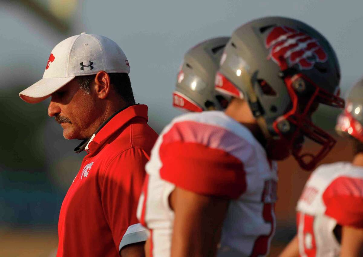Splendora head coach Marcus Schulz kicks, left, is seen before the first quarter of a non-district high school football game against Tyler Chapel Hill at Bulldog Stadium, Friday, Aug. 28, 2020, in Tyler.