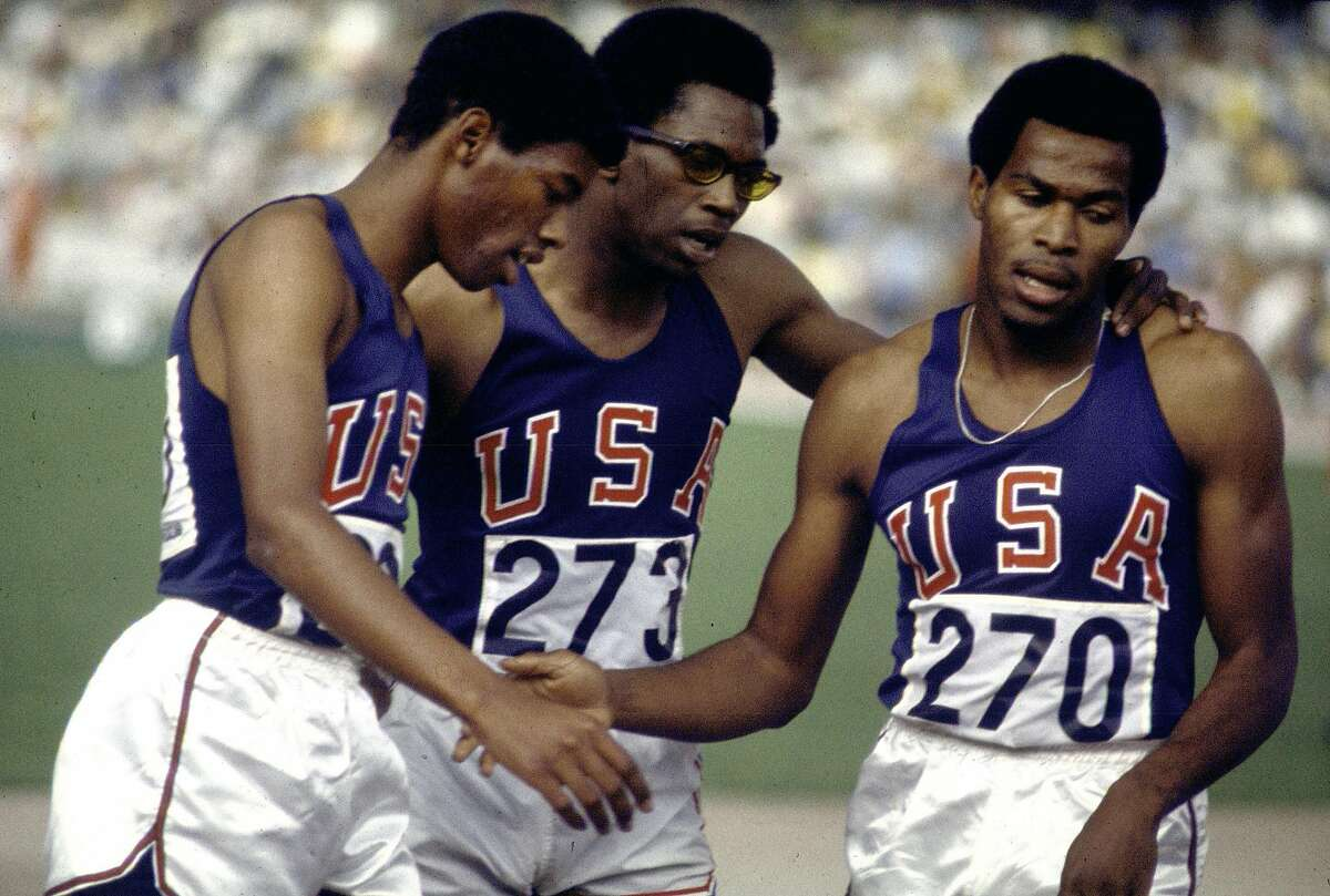Lee Evans, right, Larry James, left, and Ronald Freeman finished 1-2-3 in the 400-meter race at the 1968 Summer Olympics in Mexico City. Evans has died at the age of 74.