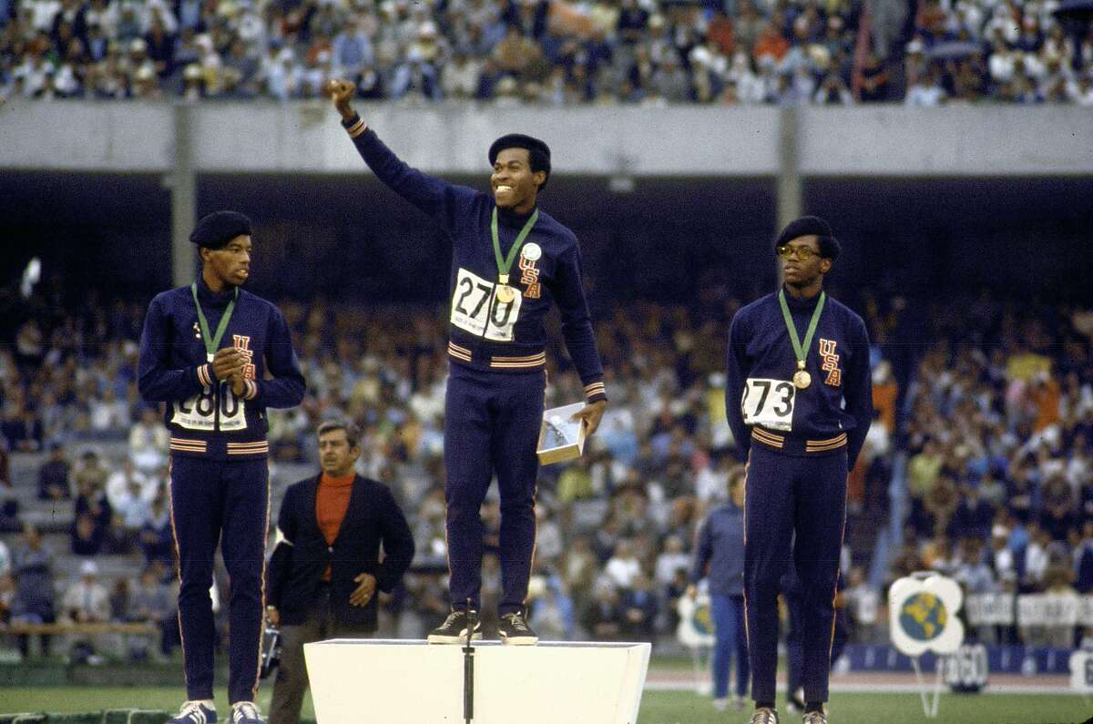 Lee Evans, center, Larry James, left, and Ronald Freeman swept the 400 meters at the 1968 Summer Olympics and wore black berets when receiving their medals to protest racial injustice in the United States.