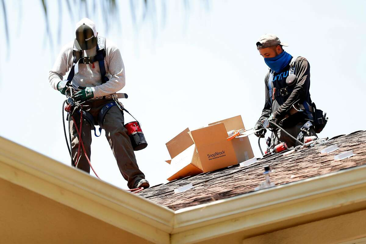 Sunrun employees prepare to install solar panels on a home in Alamo, Calif., on Monday, May 17, 2021.