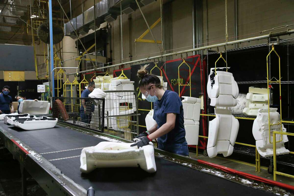 Workers produce seat padding at Avanzar Interior Technologies, Friday, Oct. 23, 2020. Avanzar makes interior parts for the Toyota Tundra and Tacoma trucks.