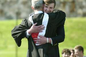 Boland Faughnan hugs Head of School Thomas Philip while receiving his diploma at the 2021 commencement ceremony at Brunswick School in Greenwich, Conn. Wednesday, May 19, 2021. 104 students graduated during the outdoor ceremony at Cosby Field, featuring a virtual commencement speech by Connecticut Gov. Ned Lamont.