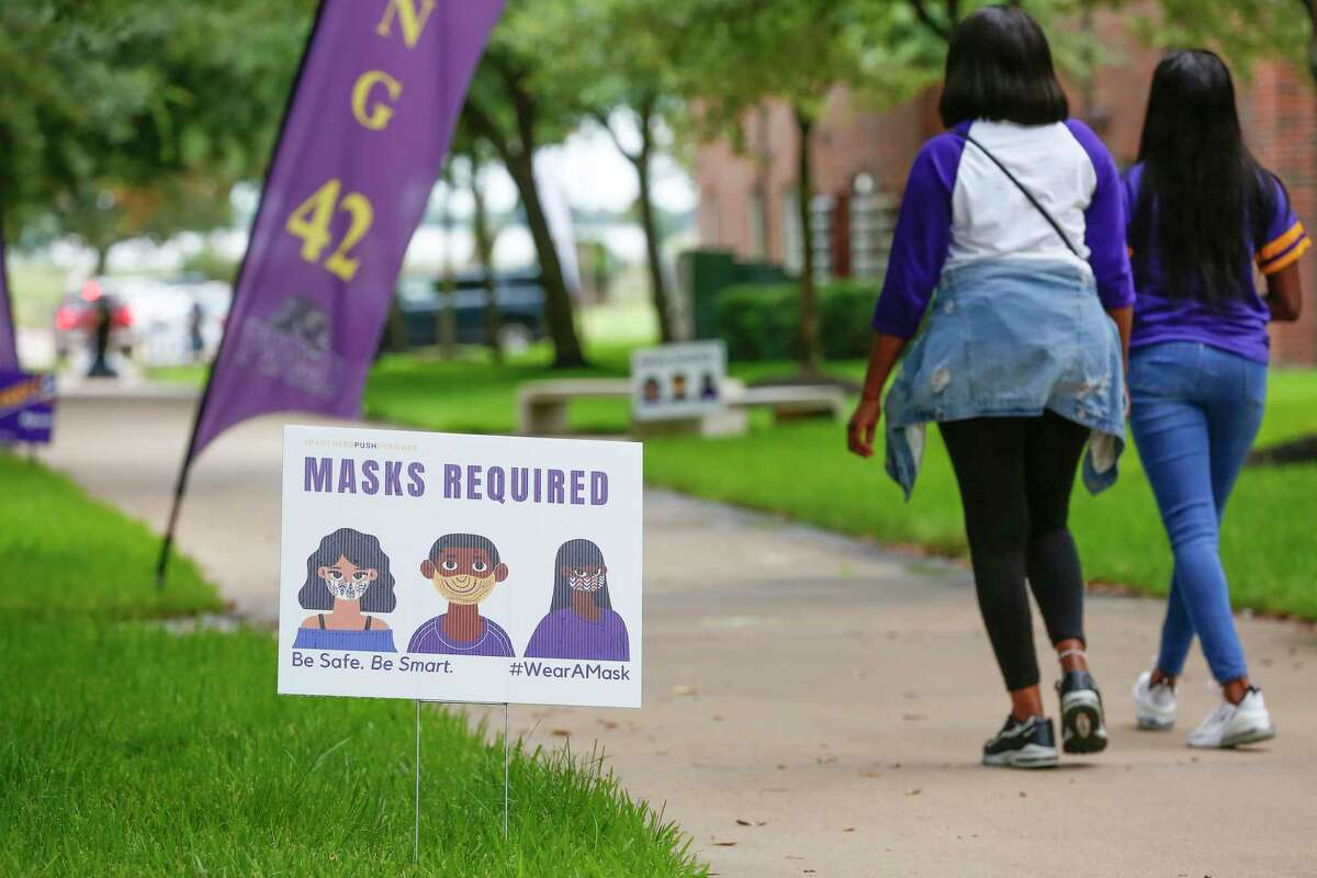 Signs for social distancing and masks were all over campus as students moved into their rooms at Prairie View A&M University Monday, Aug. 17, 2020, in Prairie View.