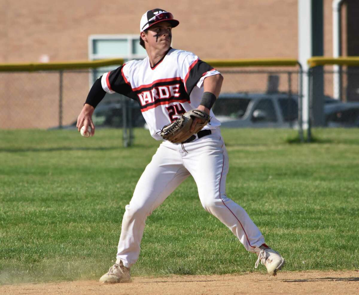 Fairfield Warde's John Heitzman throws to first base at Fairfield Warde, Fairfield on Wednesday, May 19, 2021 during a baseball game between Fairfield Warde and Greenwich.