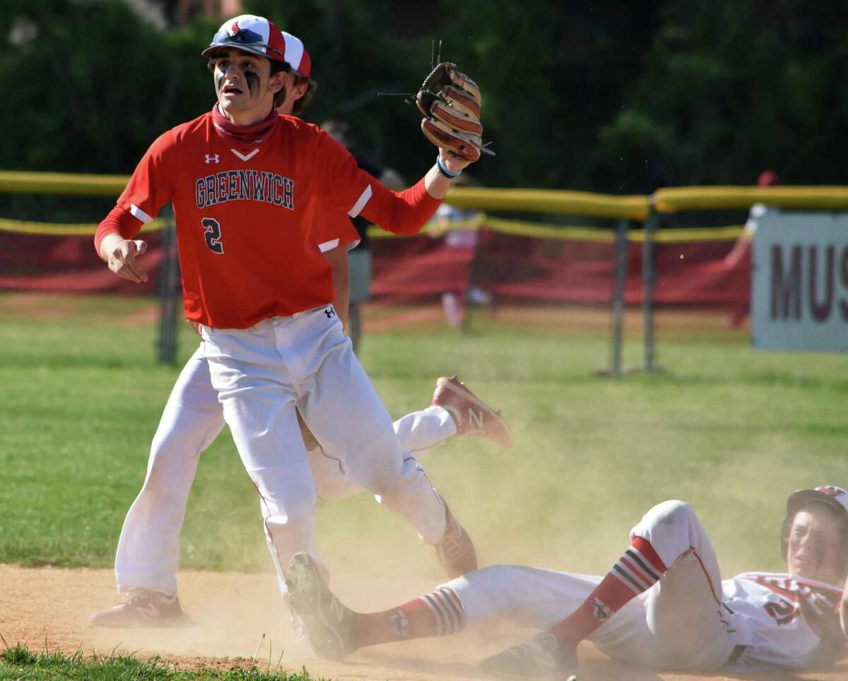 Greenwich's Christian Mingione tags out Fairfield Warde's Griffin Polley at second base at Fairfield Warde, Fairfield on Wednesday, May 19, 2021 during a baseball game between Fairfield Warde and Greenwich.