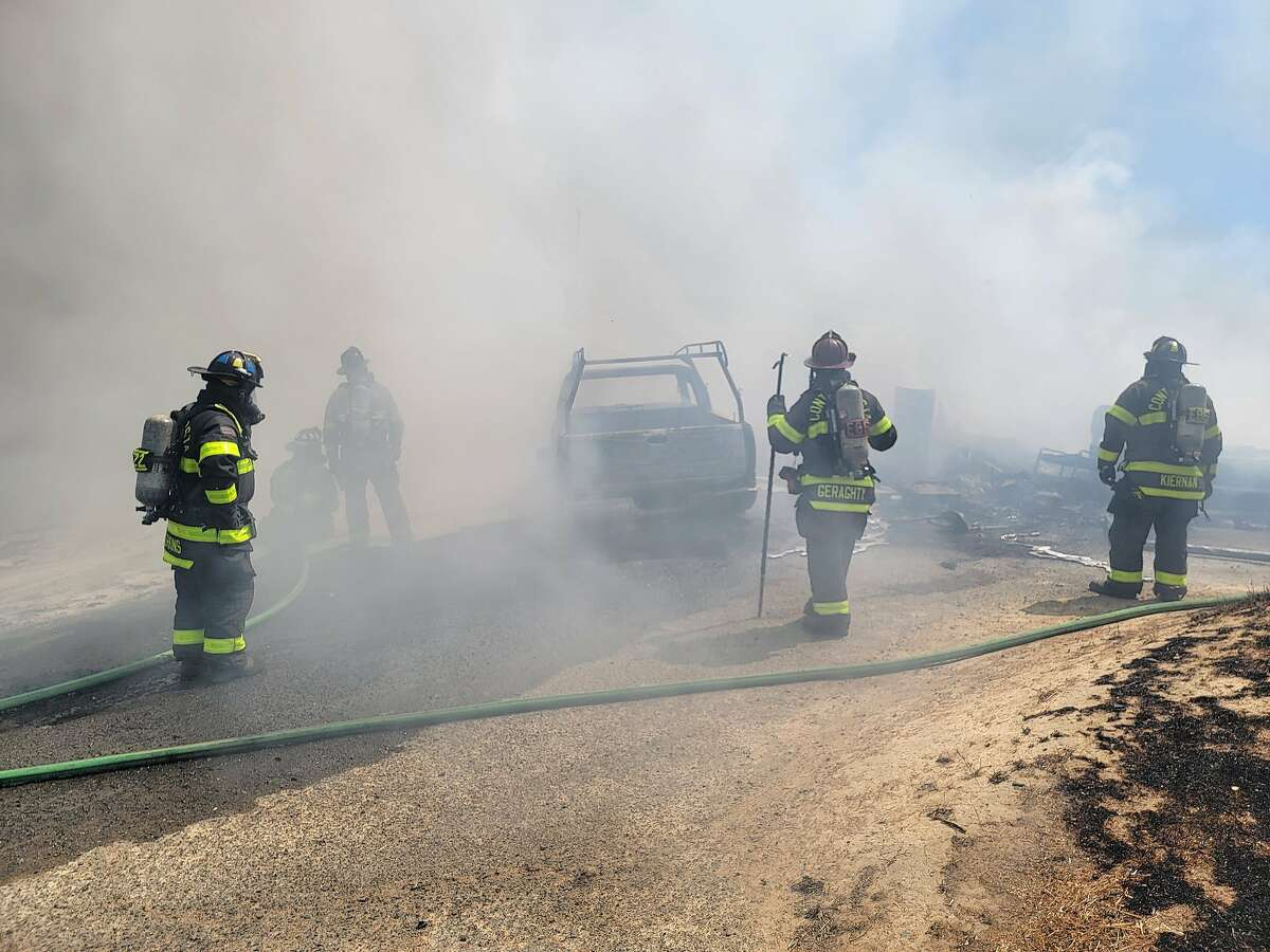 Firefighters battle a 2-alarm fire near Cambark Court in Martinez on Wednesday, May 19, 2021.