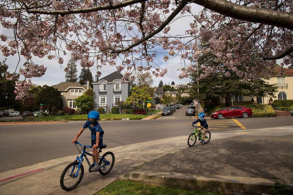 Boys round a bend near Piedmont Park on Saturday, April 3, 2021 in Piedmont, Calif.
