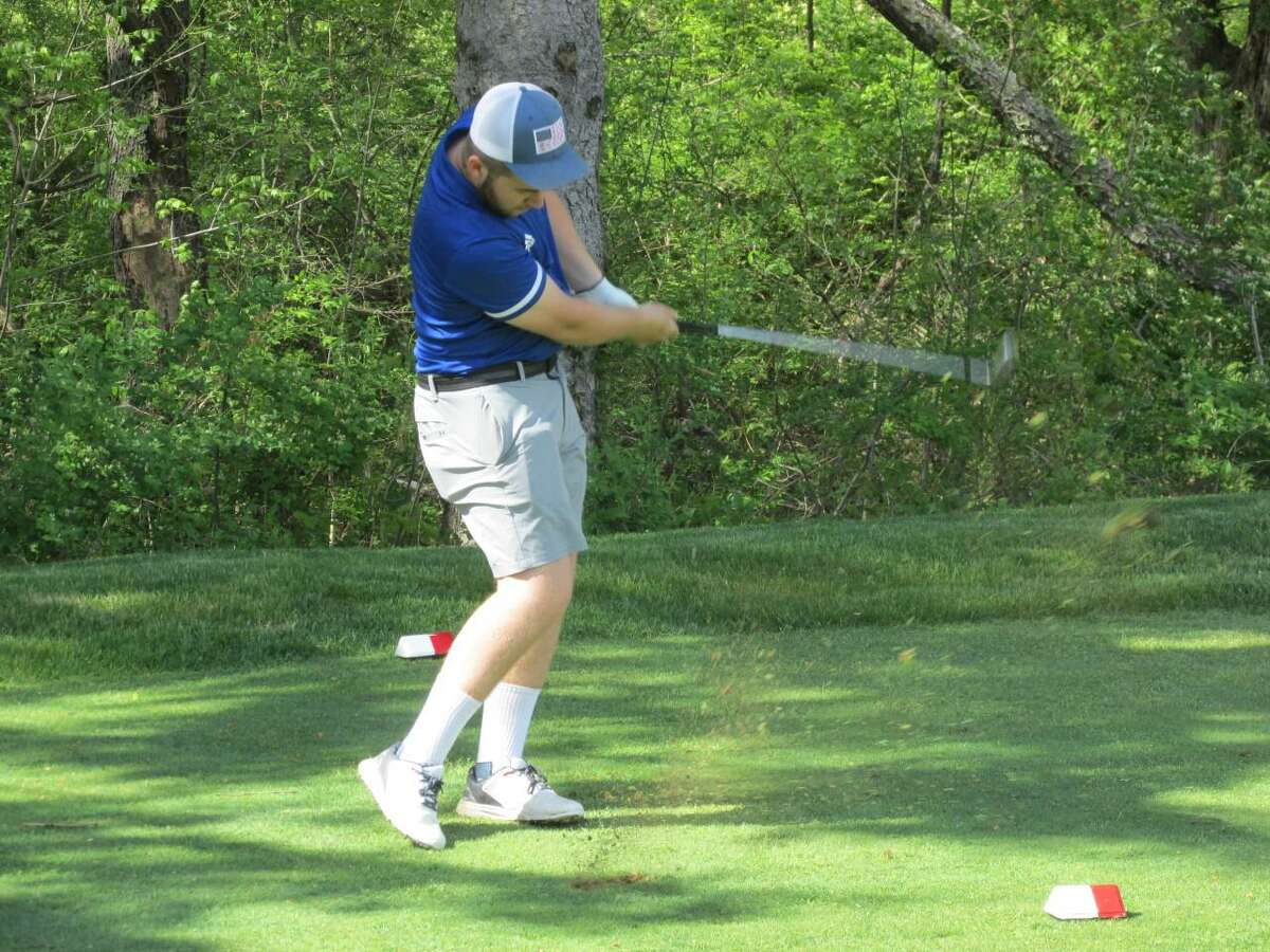 Housatonic's Will Starr tees off against Litchfield on Wednesday afternoon at Litchfield Country Club.