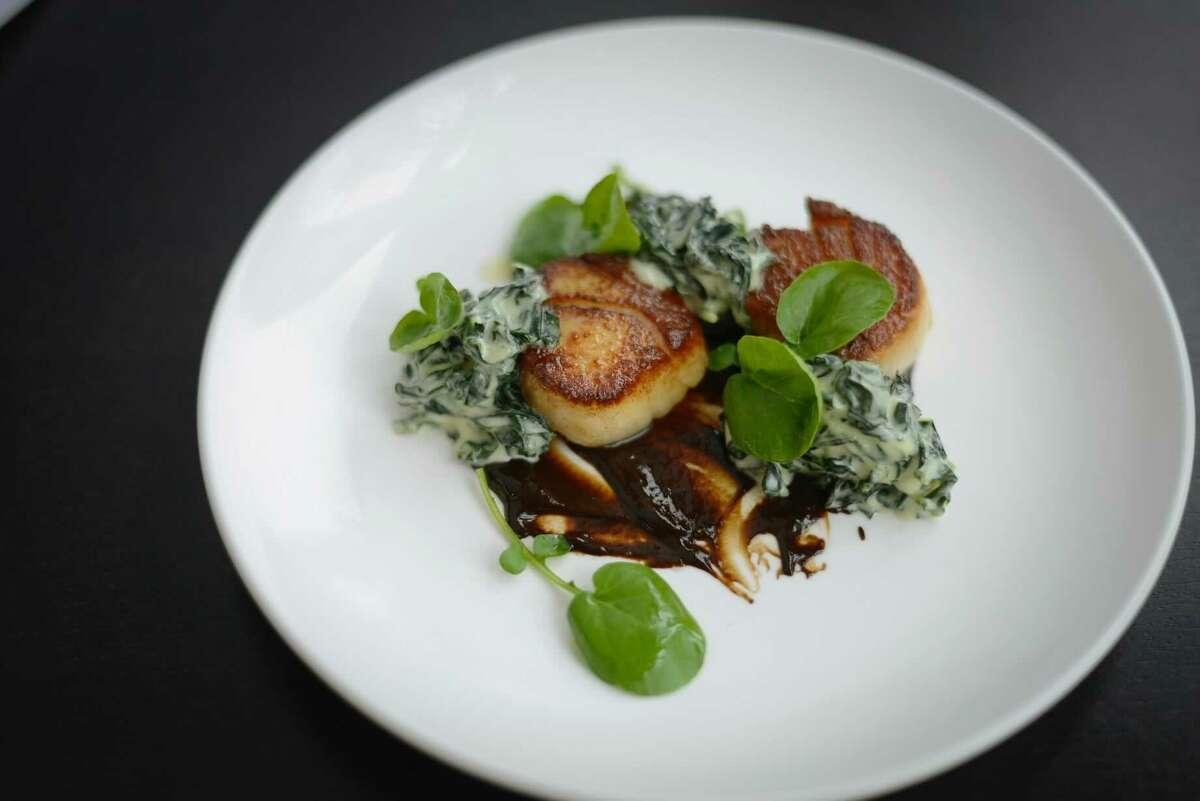 Seared scallops, creamed nettles, black garlic