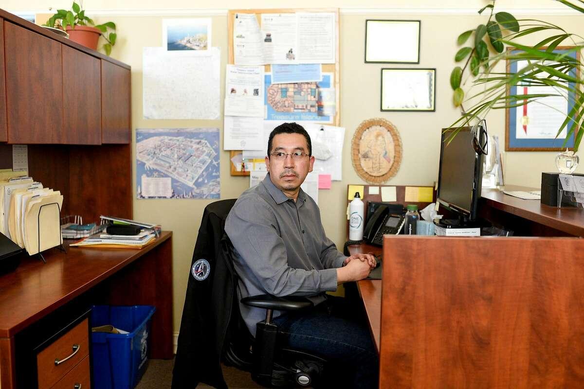 One Treasure Island Office Manager Vinicio Castro in his office.