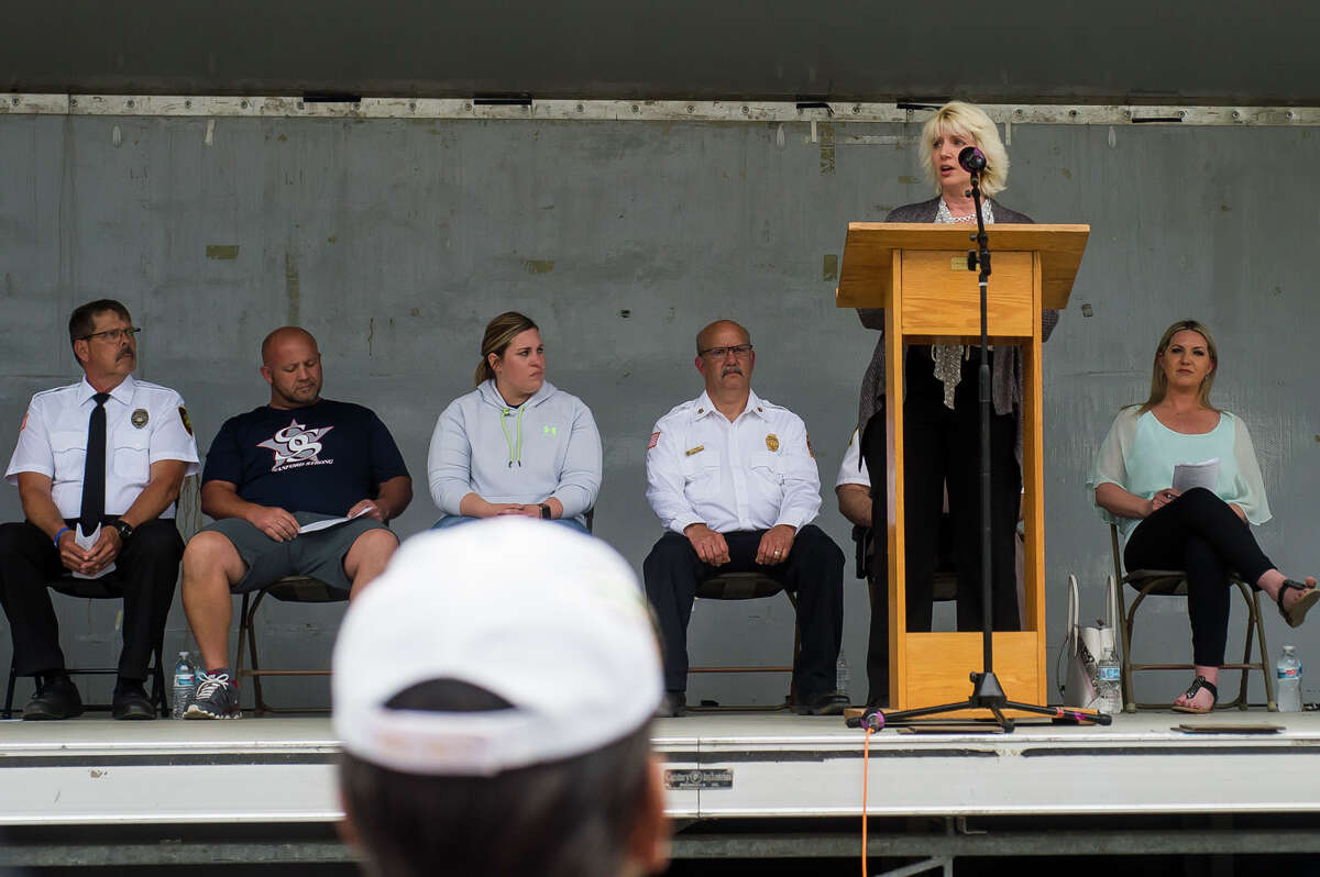 State Rep. Annette Glenn addresses the crowd during a dedication ceremony for the Sanford Veterans Monument and First Responders Monument Wednesday, May 19, 2021 in downtown Sanford. The occasion marked the beginning of the Sanford Rising celebration in honor of the one-year anniversary of the May 2020 dam failures and flood. (Katy Kildee/kkildee@mdn.net)