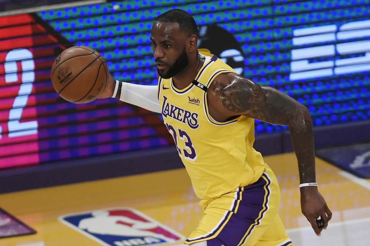 LeBron James #23 of the Los Angeles Lakers dribbles during the first half of an NBA Tournament Play-In game against the Golden State Warriors at Staples Center on May 19, 2021 in Los Angeles, California.
