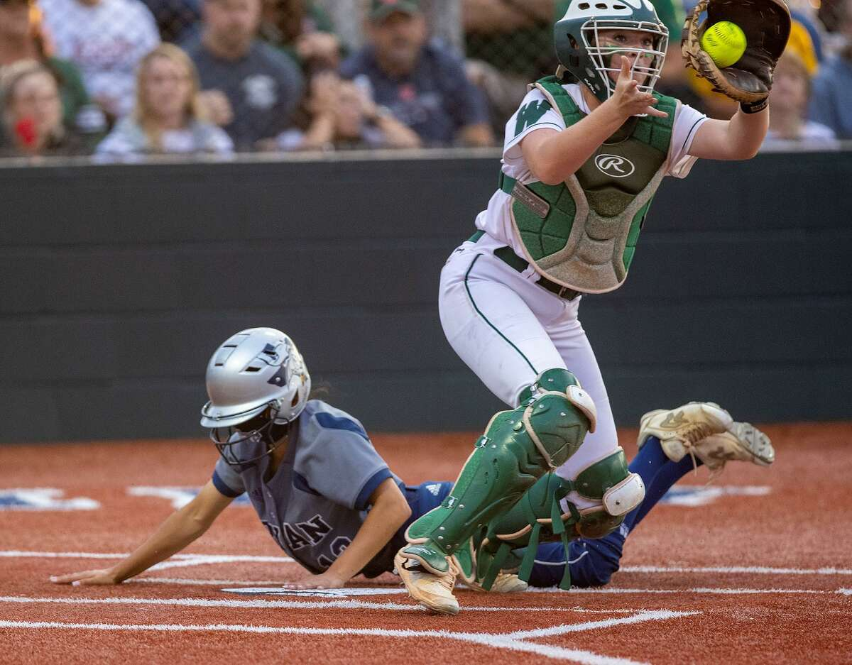 The Woodlands catcher Kiara Wiedenhaupt catches a throw at the plate in Game 1 of a Region II-6A semifinal series at Madisonville High School on Wednesday, May 19, 2021.