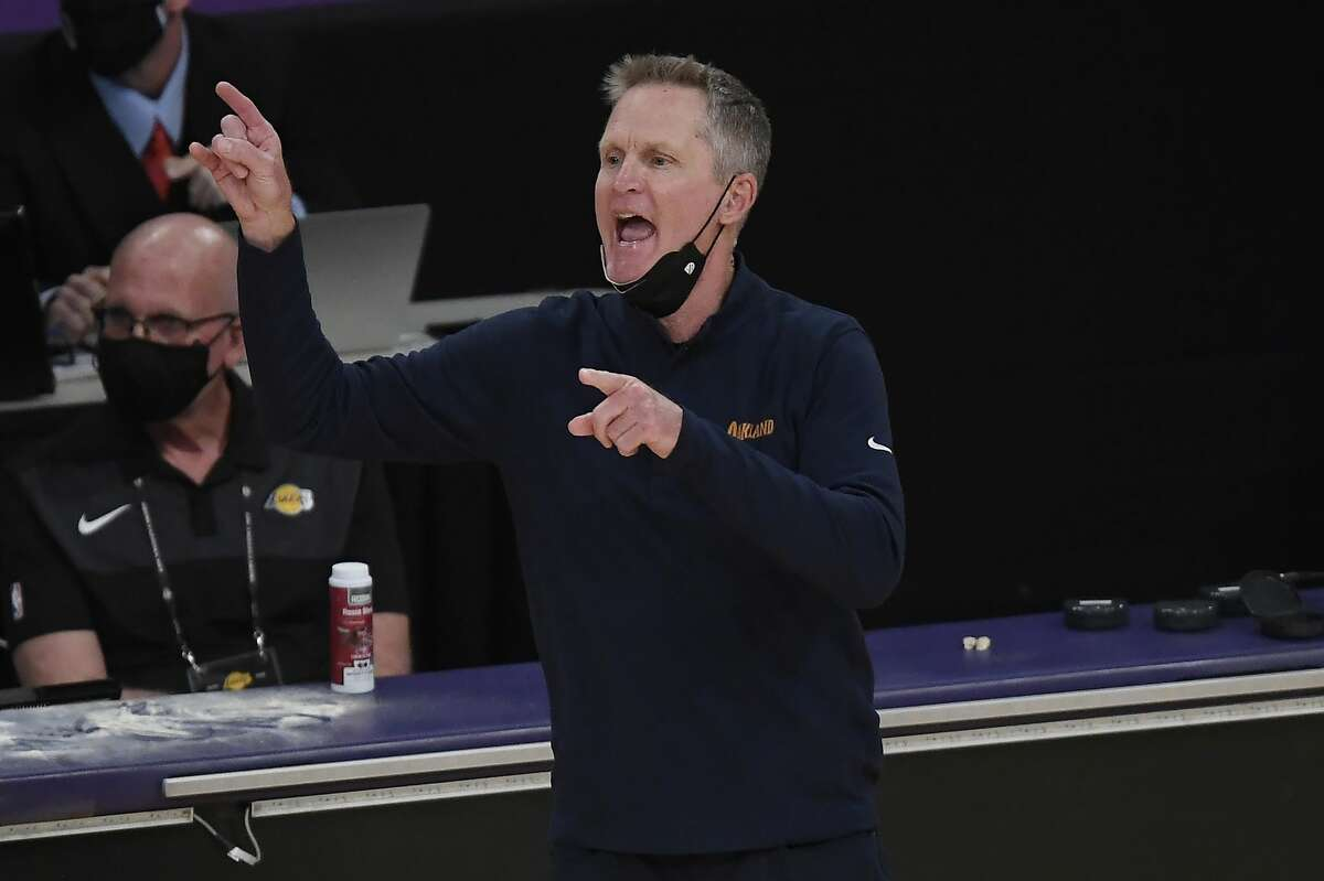 Head coach Steve Kerr of the Golden State Warriors directs his team during the first half of an NBA Tournament Play-In game against the Los Angeles Lakers at Staples Center on May 19, 2021 in Los Angeles.