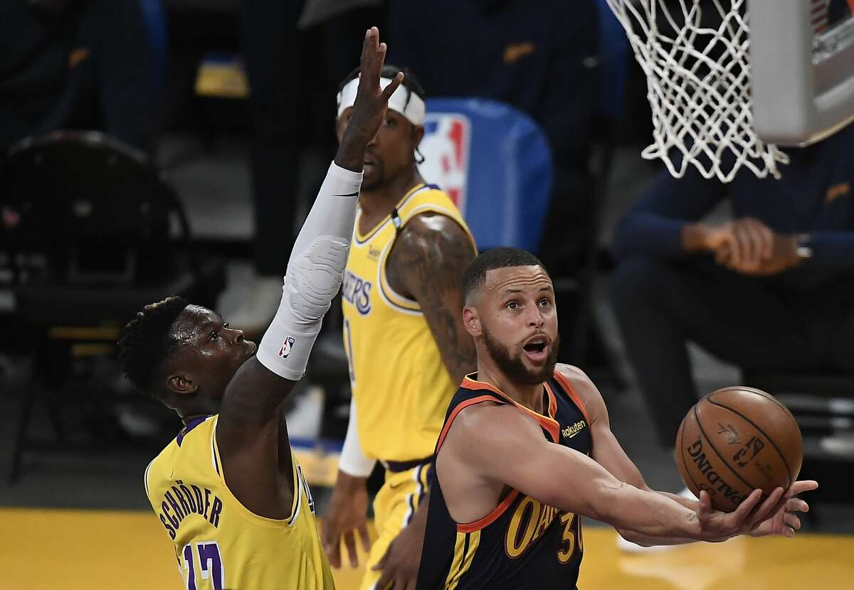 Stephen Curry #30 of the Golden State Warriors goes to the basket as Dennis Schroder #17 of the Los Angeles Lakers defends during the first half of an NBA Tournament Play-In game at Staples Center on May 19, 2021 in Los Angeles, California.