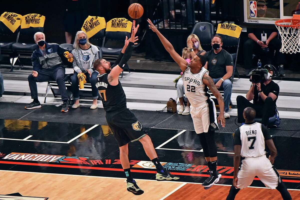 Jonas Valanciunas of the Grizzlies shoots against Rudy Gay of the Spurs during the first half of the play-in tournament game at FedExForum on May 19, 2021 in Memphis, Tenn.