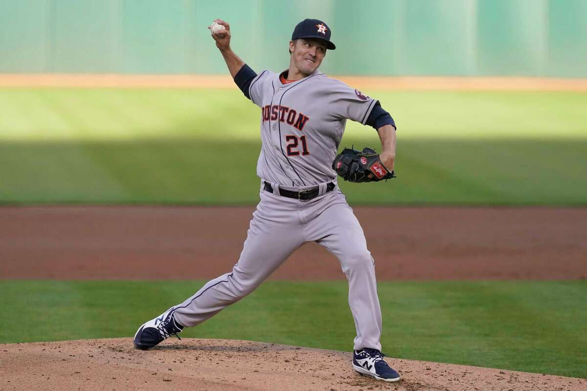 Houston Astros' Zack Greinke pitches against the Oakland Athletics during the first inning of a baseball game in Oakland, Calif., Wednesday, May 19, 2021. (AP Photo/Jeff Chiu)