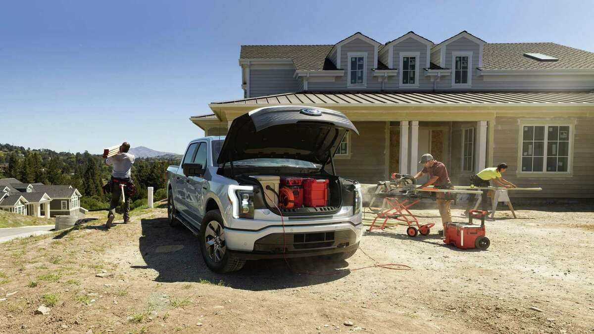 The 2022 Ford F-150 Lightning XLT offers storage space under the hood. (Ford Motor Co./TNS)