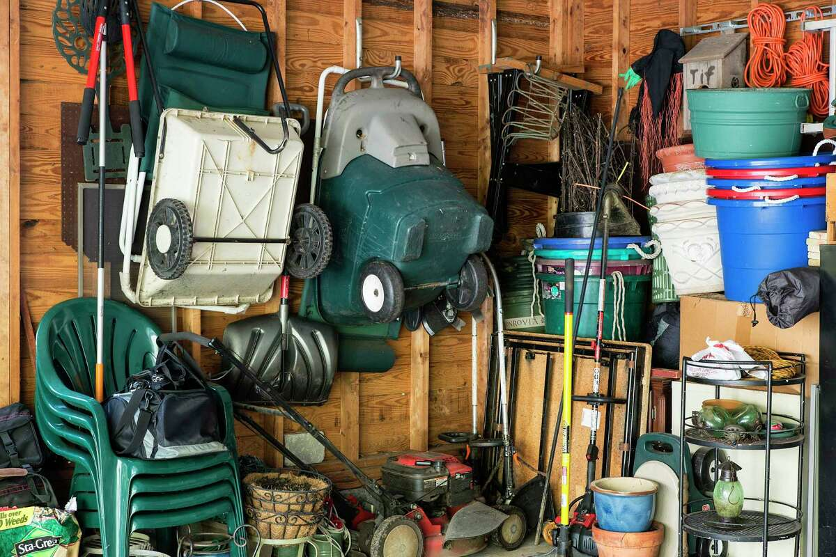 The cluttered interior of a garage in New Jersey is shown in 2013. (Photo by John Greim/LightRocket via Getty Images)