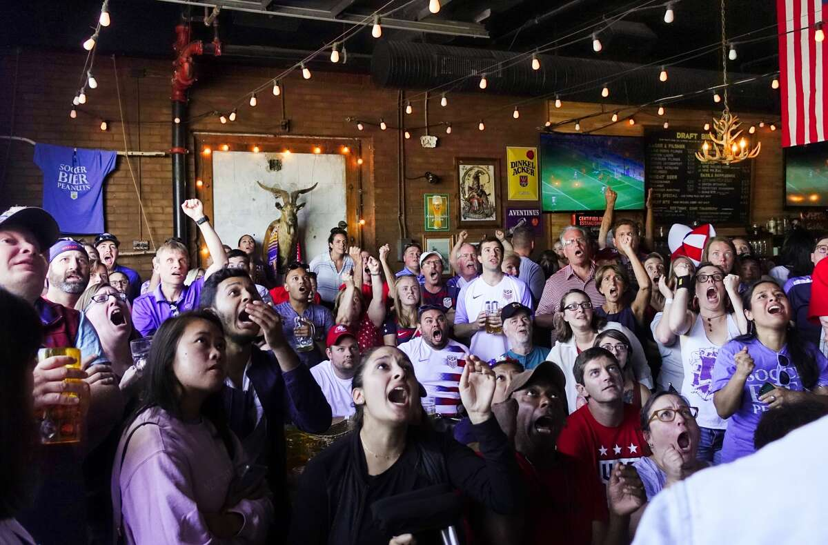 Football fans react at Wolff's Biergarten in Albany as they watch the United States women's soccer team play the World Cup final in July 2019.