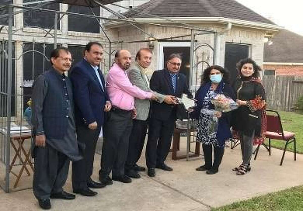 Artist Zartasha Shah is pictured with the Pioneer Mr. Abasi, President Mr. Swati, Mrs. Swati, and the members of the Hazara American Welfare Association (HAWA.) She was recognized for her art contributions to the group.