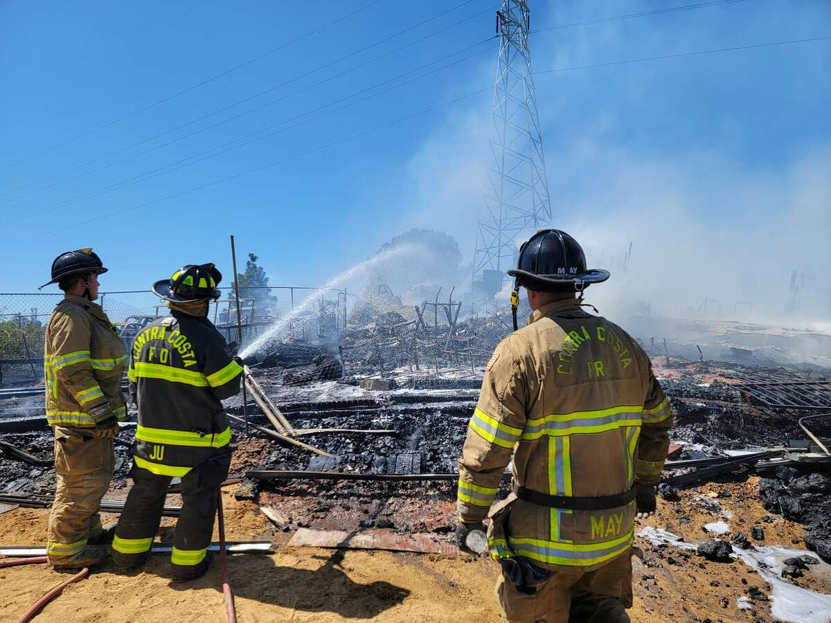 Contra Costa County firefighters on the scene at Cambark Court, where a two-alarm fire was reported Wednesday.
