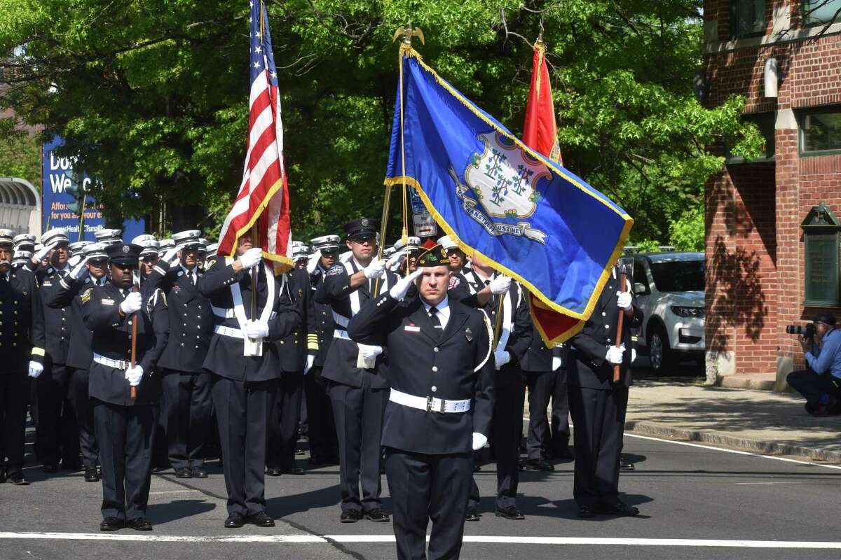 New Haven firefighters gathered ahead of the funeral for Firefighter Ricardo Torres Jr., who died last Wednesday while battling a fire on Valley Street.