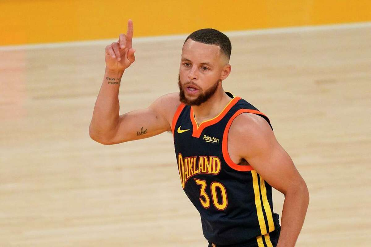 Golden State Warriors guard Stephen Curry gestures after scoring during the second half of an NBA basketball Western Conference Play-In game against the Los Angeles Lakers Wednesday, May 19, 2021, in Los Angeles. The Lakers won 103-100. (AP Photo/Mark J. Terrill)