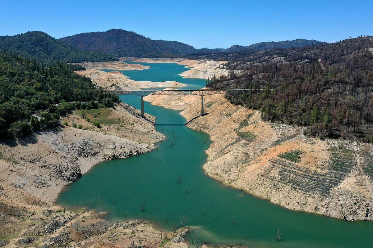In an aerial view, the Enterprise Bridge crosses over a section of Lake Oroville where water levels are low on April 27, 2021 in Oroville, California.