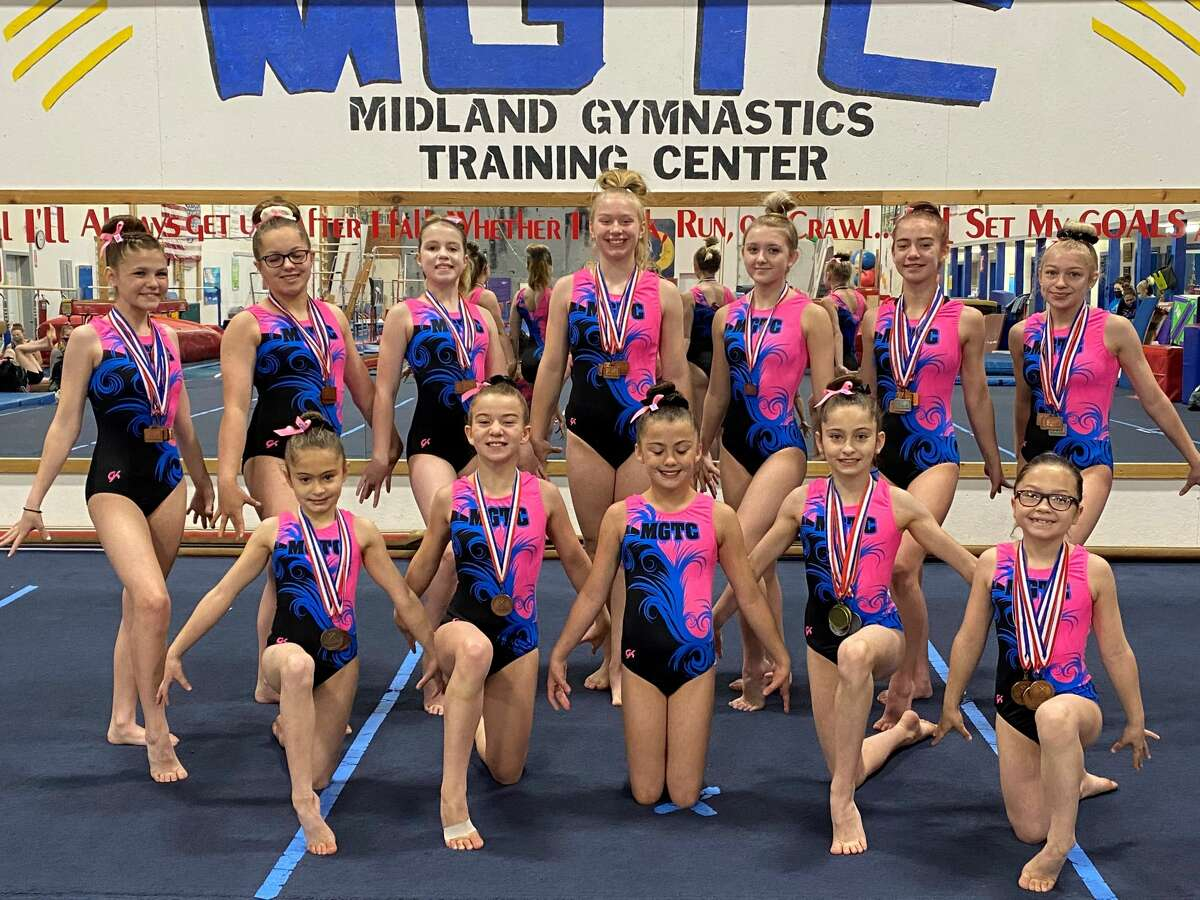 Athletes from the Midland Gymnastics Training Center who qualified for regionals this spring were (front, from left) Lucy Bond, Josi Cryderman, Kearnin Alexander, Abigail Bond, Allison Sheldon; and (back, from left) Ellie Wyatt, Taylor Santhany, Jenna Mertz, Reese Kress, Aliviah Gratson, Alexis Cryderman, and Emma Craft.