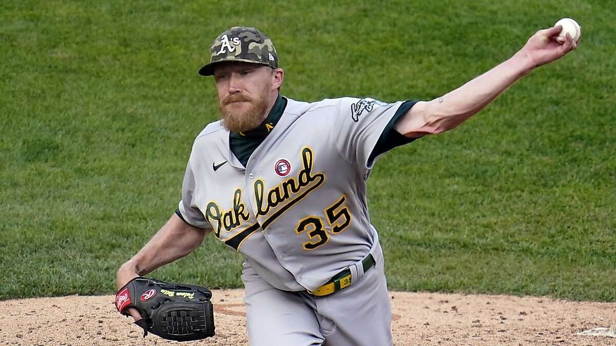 Oakland Athletics' pitcher Jake Diekman (35) throws against the Minnesota Twins in a baseball game, Saturday, May 15, 2021, in Minneapolis. (AP Photo/Jim Mone)