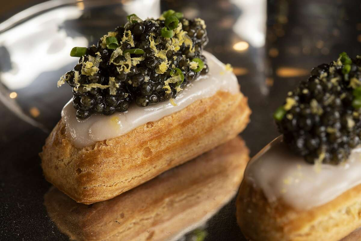 The éclair (caviar, smoked onion and cured egg yolks grated at the top) at Le Fantastique, Wednesday, May 19, 2021, in San Francisco, Calif. The new wine bar is located at 22 Franklin St.
