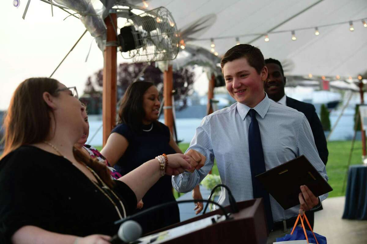 P-Tech high school students includinng Alex Zelman celebrate their graduation during a reception Wednesday, May 19, 2021, at Longshore Pavillion in Norwalk, Conn. Students in the technical program earn their associates degree while also earning their high school diploma.
