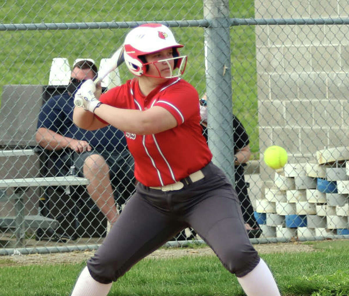 Alton's Lynna Fisher takes a pitch for a ball in a game earlier this season at Alton High in Godfrey. On Wednesday at O'Fallon, Fisher hit two home runs to lead the Redbirds to a SWC softball victory.